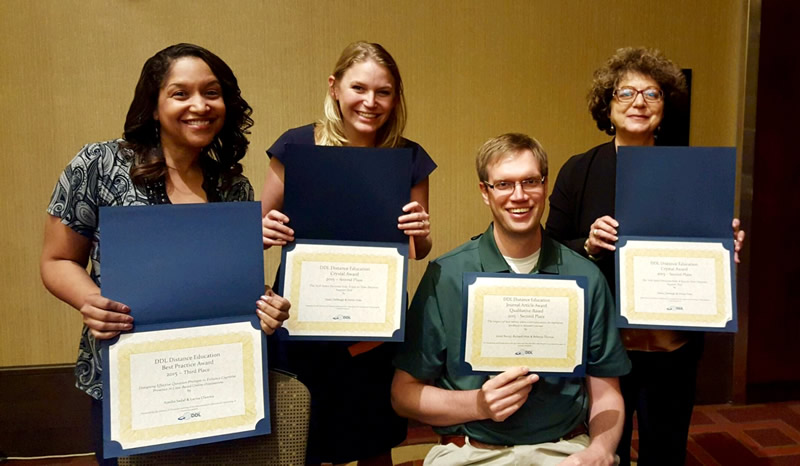 IDT program students and faculty receiving awards from AECT's Division of Distance Learning